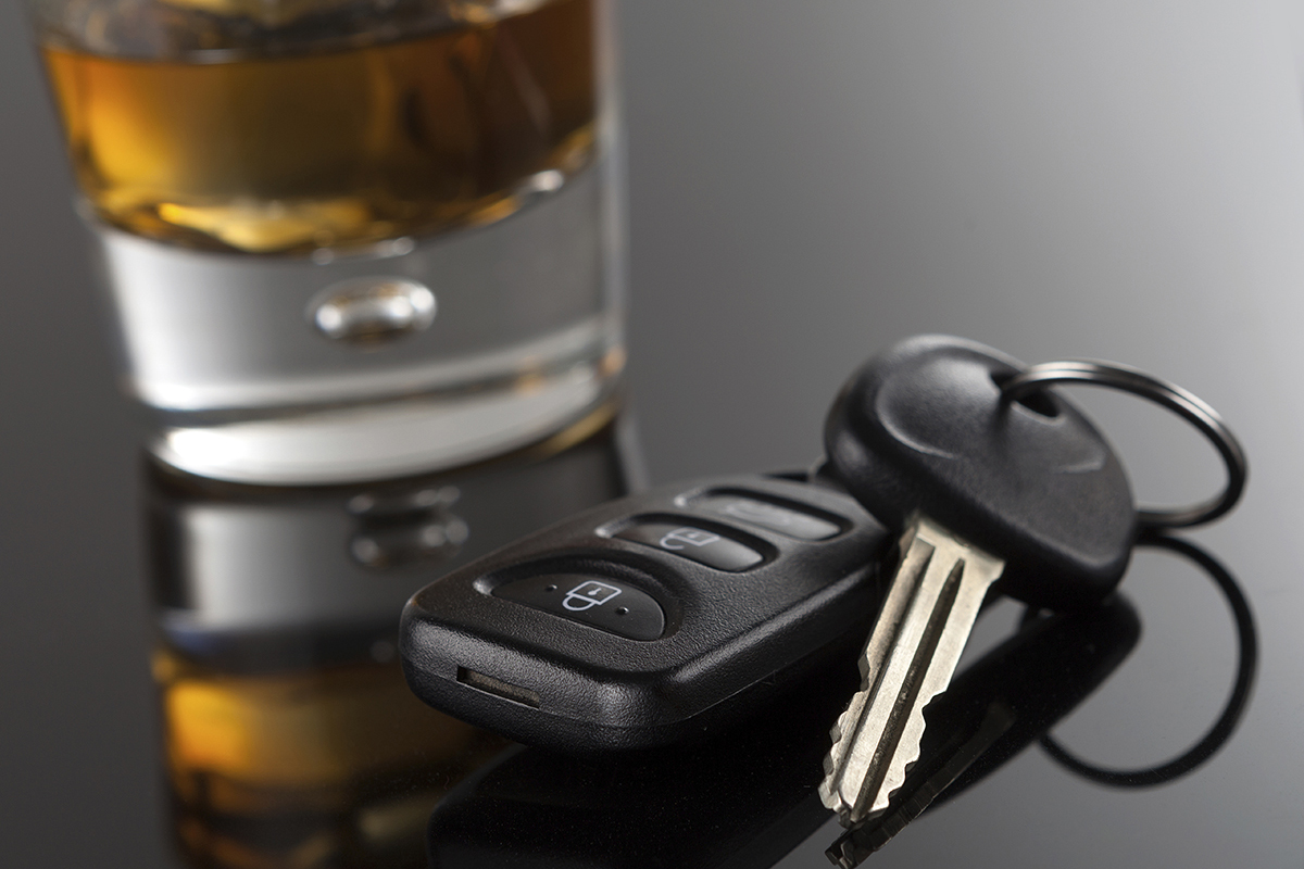 cars keys and alcoholic drink